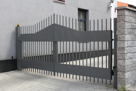 closed community: Modern automatic metal gate Stock Photo