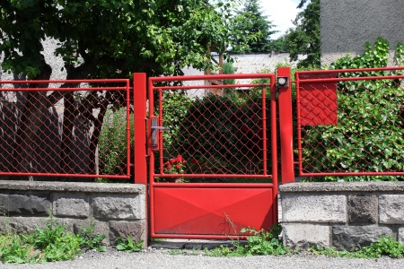 closed community: vintage red fence with gate