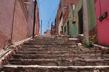Narrow street with stairs colorful buildings photo