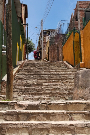 Lovely narrow street with stairs in Guanajuato, Mexico photo