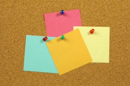 thumb tack: Colorful blank note card with push pins on cork board