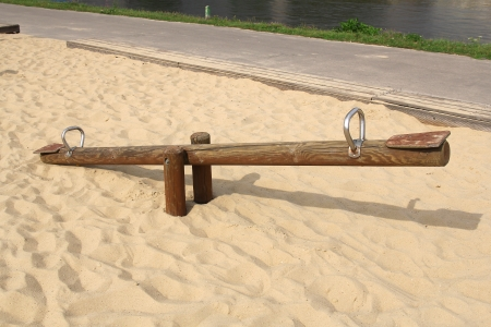 see saw: wooden sea saw on sand
