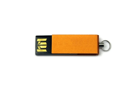 gold pendrive on white background  photo