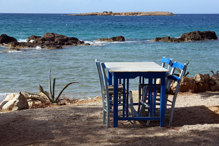 Restaurant near the beautiful turquise sea in Chania, Crete photo