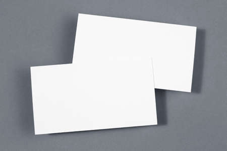 Two business card on grey paper background photo