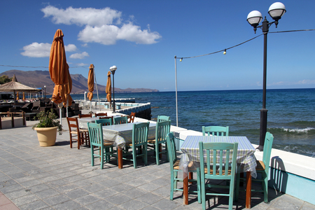 Restaurant on the seaside in Crete, Greece photo