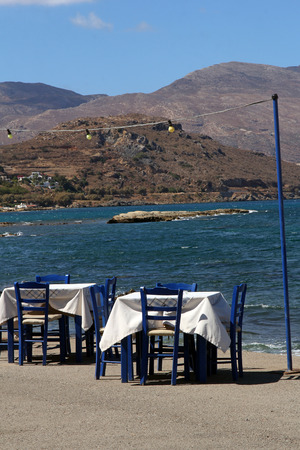 Restaurant near the beautiful turquoise sea in Kastelli, Crete photo