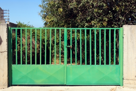 closed society: Green metal gate