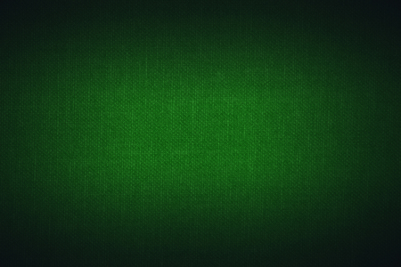 bright center:  green linen texture with with bright center spotlight and black vignette frame