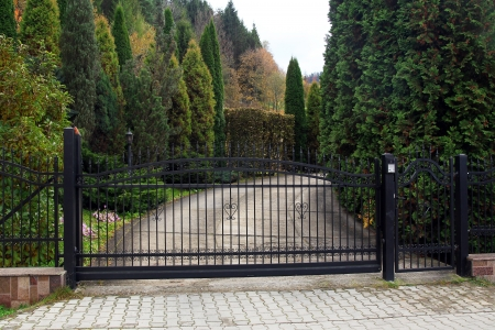closed community: black wrought gate and driveway