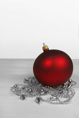 Christmas background- red bauble with silver chain photo