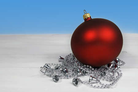 Christmas decoration with red bauble and silver chain photo
