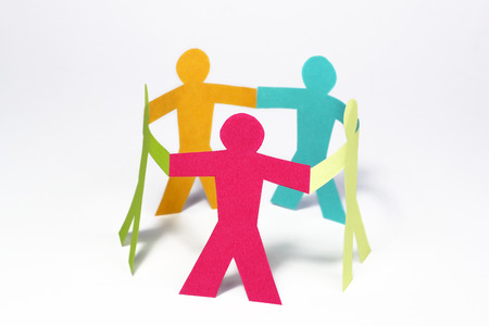 circle of colorful paper people on white background  photo