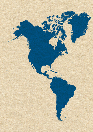Map of North and South America- blue on yellow paper background photo