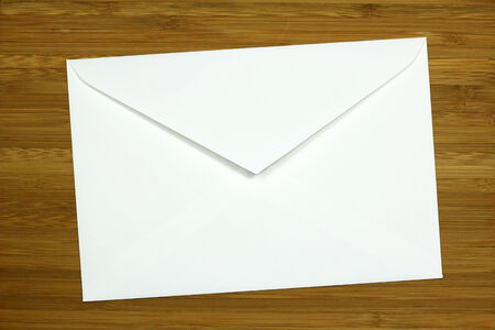 white envelope on wooden background  photo