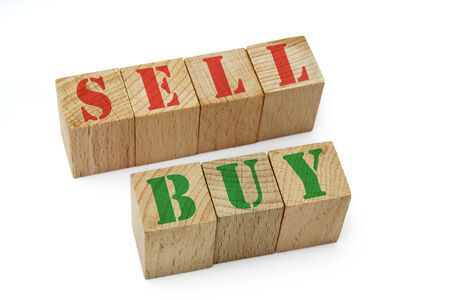 sell and buy text on wood cubes photo