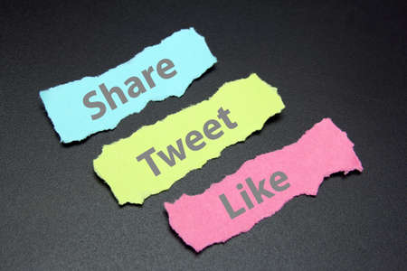tweet: share, tweet and like on ripped papers, social media services  Stock Photo