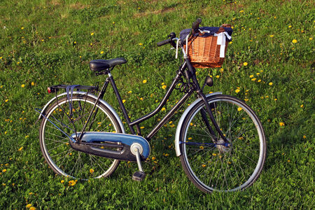 vintage bike with rattan basket photo