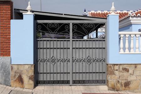 grey metal gate  grey metal gate  photo