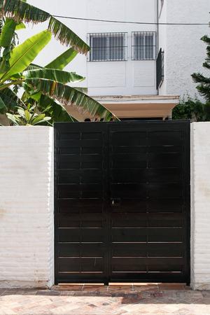 black modern gate and banana tree  photo