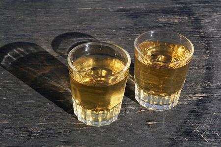 vineyard plain: Two glass of white vine on oak barrel
