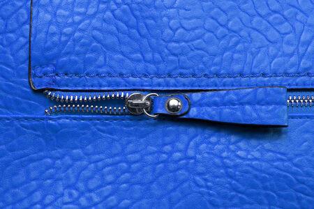 zipper on blue leather  photo