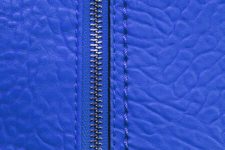 blue leather background with zipper  photo