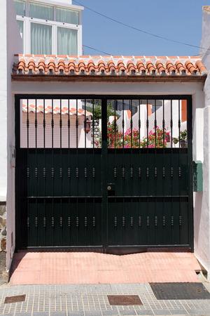 open garden gate:  black gate