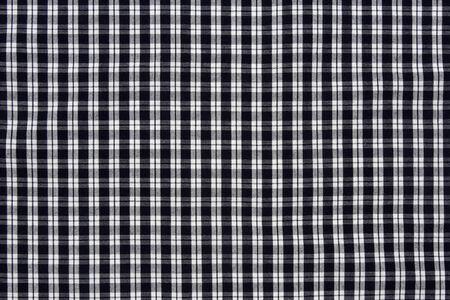 black and white checkered fabric background  photo