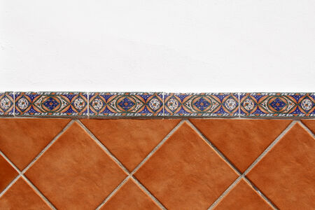 white wall and brown tiles background