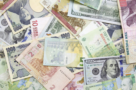 verschillende vreemde valuta achtergrond Stockfoto