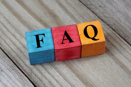 Concept of FAQ word on wooden colorful cubes Zdjęcie Seryjne - 30909228