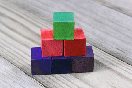 childchood: podium or tower of wooden colorful blocks