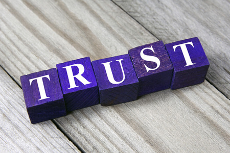 ethic: trust concept- word on wooden cubes  Stock Photo