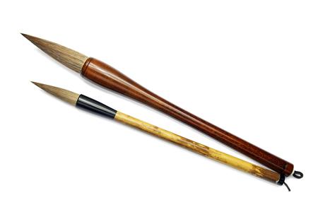 sumi e: japanese writing brushes isolated on white background