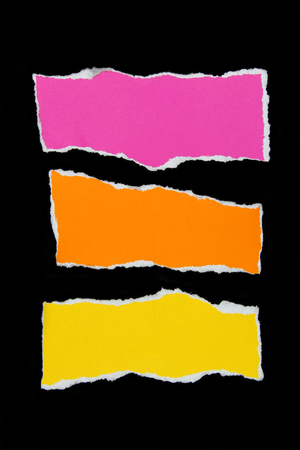 colorful torn paper on black paper background photo