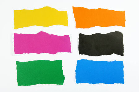colorful torn paper on white background photo