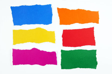 colorful torn paper layers on white background photo