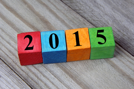 concept of Happy New year 2015 on wooden colorful cubes Stock Photo