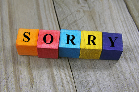 concept of sorry word on wooden colorful cubes photo