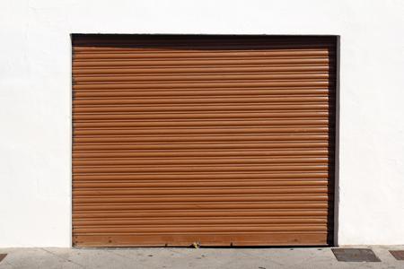 garage door: brown metal garage door