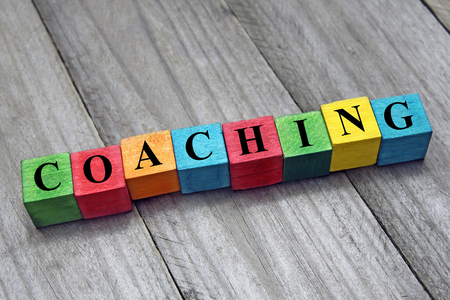 coaching word on wooden colorful cubes