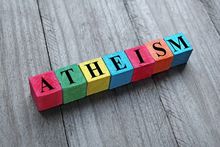 atheism: atheism word on colorful wooden cubes