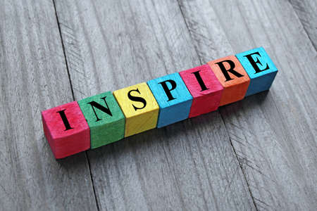 word inspire on colorful wooden cubes