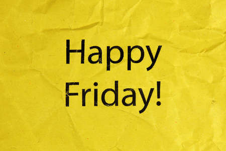 buzzwords: Happy Friday text on paper