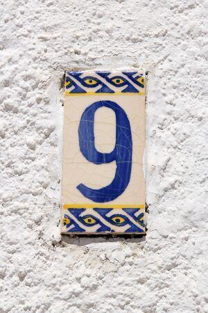 adress: Nine adress plate number