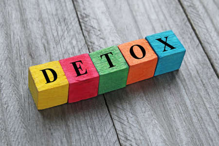 detoxing: detox word on colorful wooden cubes