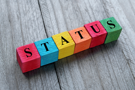 status word on colorful wooden cubes