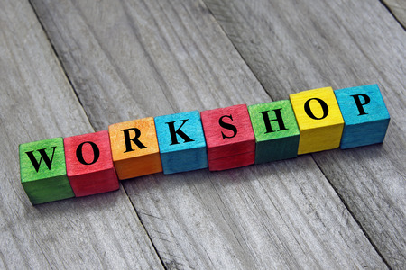 Word workshop on colorful wooden cubes