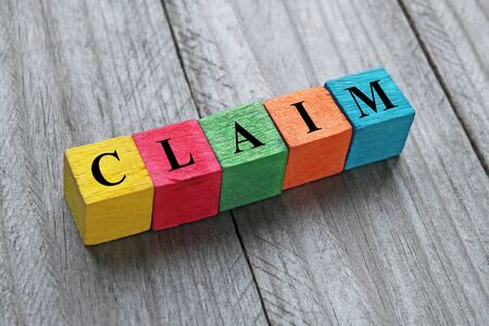 assertion: Word claim on colorful wooden cubes Stock Photo